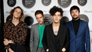 The 1975 make their grand entrance